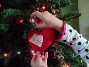 Pinky-Pie putting on her home-made ornament