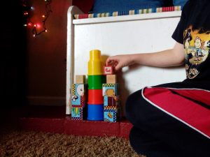 First Born stacking blocks for the baby destroyer to attack