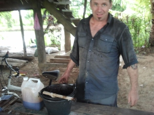 Aaron, the CEO, making natural  fertilizer rich in microorganisms from mollases, freshwater crab and snails (which live in the rice paddies).
