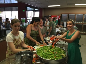 The food prep team preparing a mega-sized bowl of salad