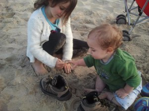 I think Little B was trying to play his own April Fool's joke on big brother by filling his shoes with sand.