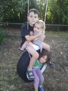 The kids enjoying their tire swing at Grammy's for the last time.