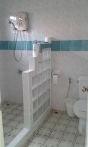 A western bathroom with a physical divider between toilet and shower!