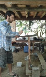 Yes, that's me using a machete! It's basically the only way we cut and shape wood.