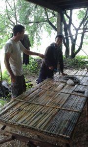 Sak Chai, our farm manager, and myself discussing next steps for the nursery. This is one of the finished tables.