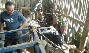 Sean taking apart the mill, Aaron demolishing the concrete.