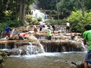 Three families of kids scaling the multi-leveled waterfall of Pachaeron.