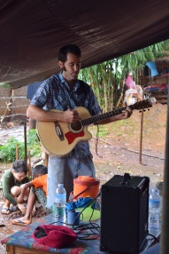 Me playing guitar while friends were praying for physical healing.